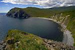 Россия, Магаданская область, полуостров Кони, берег Охотского моря, на дальнем плане мыс Блиган